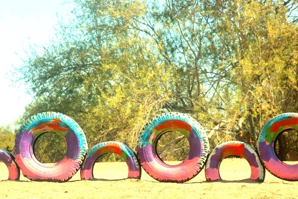 tire wheels leading to yard of imagination
